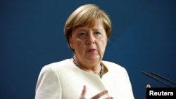 Ангела Меркел, садри аъзами Олмон