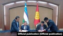 Подписание протокола руководителями делегаций.