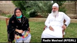 Kumari sits with Mian Javed in his garden soon after her conversion from Hinduism to Islam.