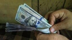 Aşgabat: Gara bazarda dollar 24 manada çenli arzanlady