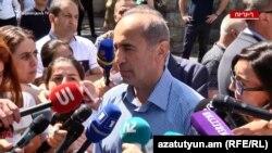 Robert Kocharian talks to journalists after casting his vote in Yerevan on June 20.