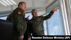 Russian Defense Minister Sergei Shoigu (center) and General Valery Gerasimov (left) observe military drills in Crimea on April 22.