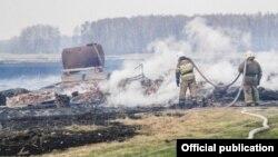 Firefighters tackle the blaze in the village of Karakul.