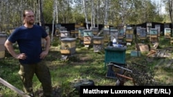 """Sergei Surovtsev has 100 beehives on his homestead in Russia's Far East. """"When I come here, I enter a meditative state,"""" he says."""