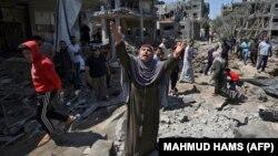 Palestinka reaguje na posjedice vazdušnih napada Izraela u Beit Hanunu, na sjeveru Pojasa Gaze, 14. maj 2021.