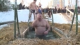 Orthodox Christians Celebrate Epiphany With Icy Plunges
