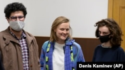 Three of the four Doxa magazine editors in a Moscow court on April 14.