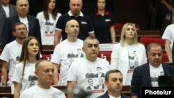 Armenia - Deputies from the opposition Hayastan bloc wear T-shirts emblazoned with pictures of arrested opposition figures during the inaugural session of the recently elected National Assembly, Yerevan, August 2, 2021.