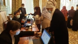 Kyrgyz voters cast their ballots at a polling station in the southern city of Osh on April 11.