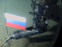 Russian flag being planted under the North Pole