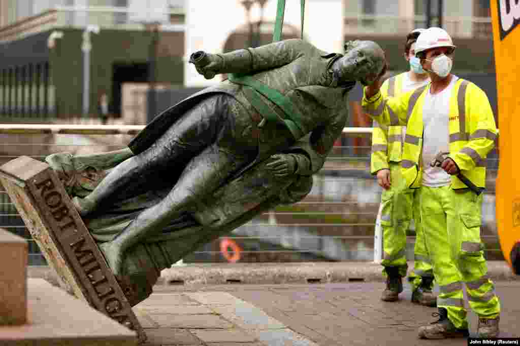 "A statue of Robert Milligan, a noted slaveholder, is pictured being removed by workers outside the Museum of London Docklands near Canary Wharf, following the death of George Floyd who died in police custody in Minneapolis, London, Britain, June 9, 2020. The mayor of London, Sadiq Khan, announced a review of all of city's statues and street names, saying those with links to slavery ""should be taken down""."