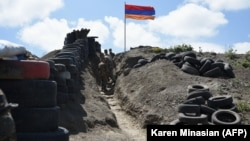 Armenian soldiers at a border checkpoint between Armenia and Azerbaijan near the village of Sotk. (file photo)
