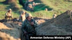 Armenian soldiers take up positions on the front line in the Tavush region on July 14.