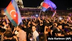 AZERBAIJAN -- People carry Azerbaijn's national flags as they rally in Baku, July 14, 2020