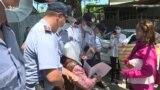 Сотый день протестов: участников акции у китайского консульства задержали