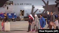Families evacuated from Kabul arrive in the Kosovar capital, Pristina, on August 29.