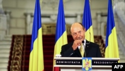 Romanian President Traian Basescu delivers a speech at the Cotroceni Palace in Bucharest on July 3.