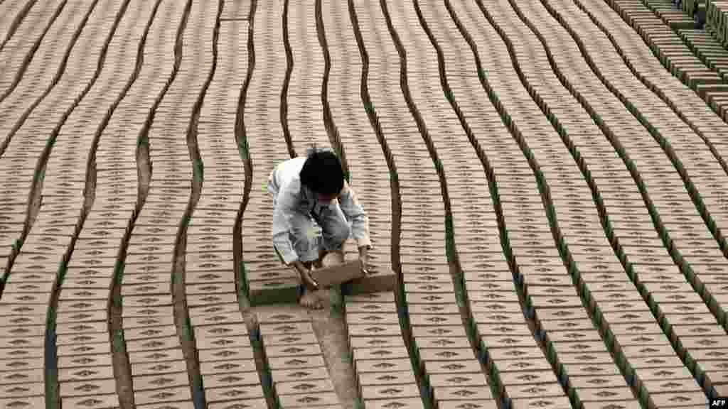A child laborer works at a brick factory on the outskirts of Lahore, Pakistan. (AFP/Arif Ali)