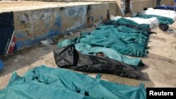 Body bags containing African migrants, who drowned trying to reach Italian shores