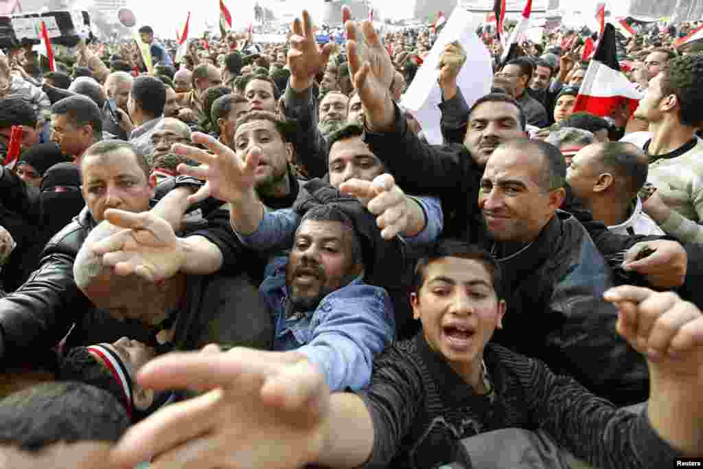 Hungry and thirsty protesters reach out for food and drink during mass demonstrations in Tahrir Square on February 8, 2011.