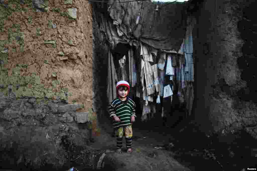 A girl stands at the entrance to her house in a slum on the outskirts of Islamabad, Pakistan. (Reuters/Zohra Bensemra)