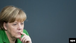 German Chancellor Angela Merkel listens to a speech during a Bundestag session in Berlin, 18 November 2013.