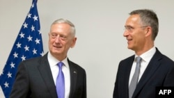 U.S. Secretary for Defense Jim Mattis (L) speaks with NATO Secretary-General Jens Stoltenberg prior to a meeting at NATO headquarters in Brussels on June 29.