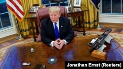 Президент США Дональд Трамп в овальном кабинете Белого дома. 11 декабря 2018 года.