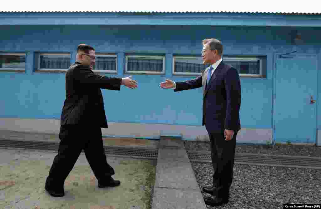 North Korean leader Kim Jong Un prepares to shake hands with South Korean President Moon Jae-in at the border village of Panmunjom in the demilitarized zone between the two states on April 27. (Korea Summit Press/AP)