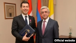 President Serzh Sargsyan awards a medal to his son-in-law and Armenian Ambassador to the Vatican Mikayel Minassian, April 5, 2018.