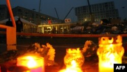 Candles were lit in front of the collapsed shopping center in Riga on November 22.