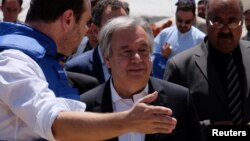 United Nations Secretary-General Antonio Guterres (center) visits a camp for internally displaced people outside Kabul on June 14.