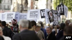 Demonstrators protest outside U.K. Prime Minister Gordon Brown's office at 10 Downing Street in central London.