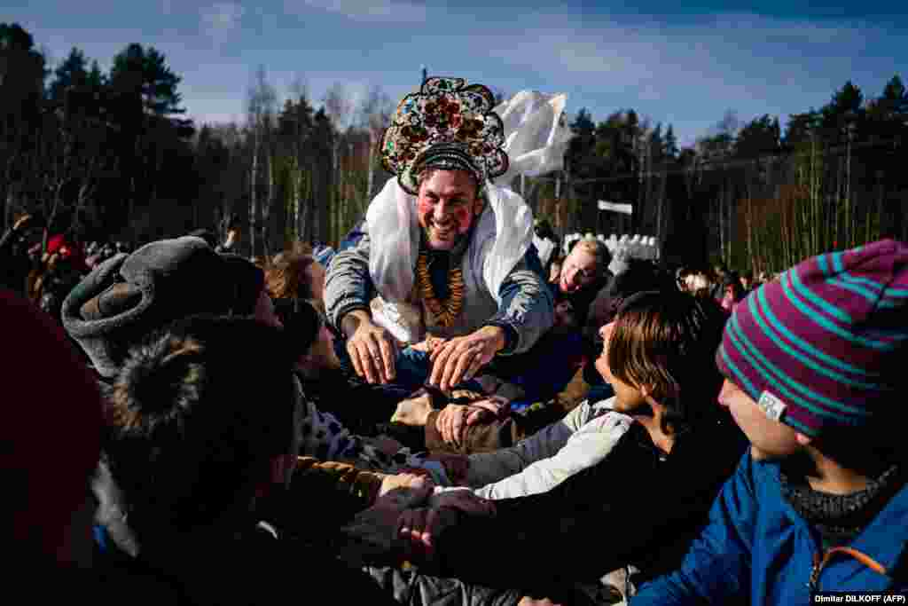 People take part in Maslenitsa celebrations close to the village of Khlyupino, some 60 kilometers outside of Moscow, on March 1.