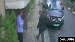 CCTV footage shows Saudi journalist Jamal Khashoggi (right) arriving at the Saudi Consulate in Istanbul on October 2.