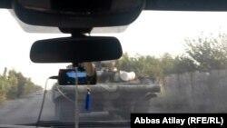 Таулы Қарабақтағы Армения әскері басып алған Агдам ауданына кірген Әзербайжан танкісі. 2 тамыз 2014 жыл.
