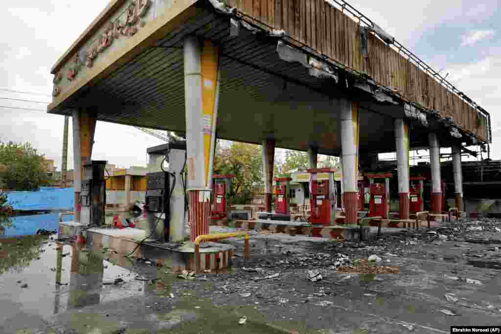 "A heavily damaged gas station in Tehran. There have been unconfirmed reports that as many as 200 people were killed in the demonstrations nationwide. Amnesty International, citing eyewitness accounts, reported security personnel shooting into crowds from rooftops and ""in one case, a helicopter."""