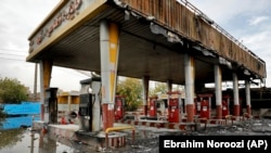 A gas station shows damages after it was attacked and burned during protests over rises in government-set gasoline prices, in Tehran, Iran, Wednesday, Nov. 20, 2019. FILE PHOTO