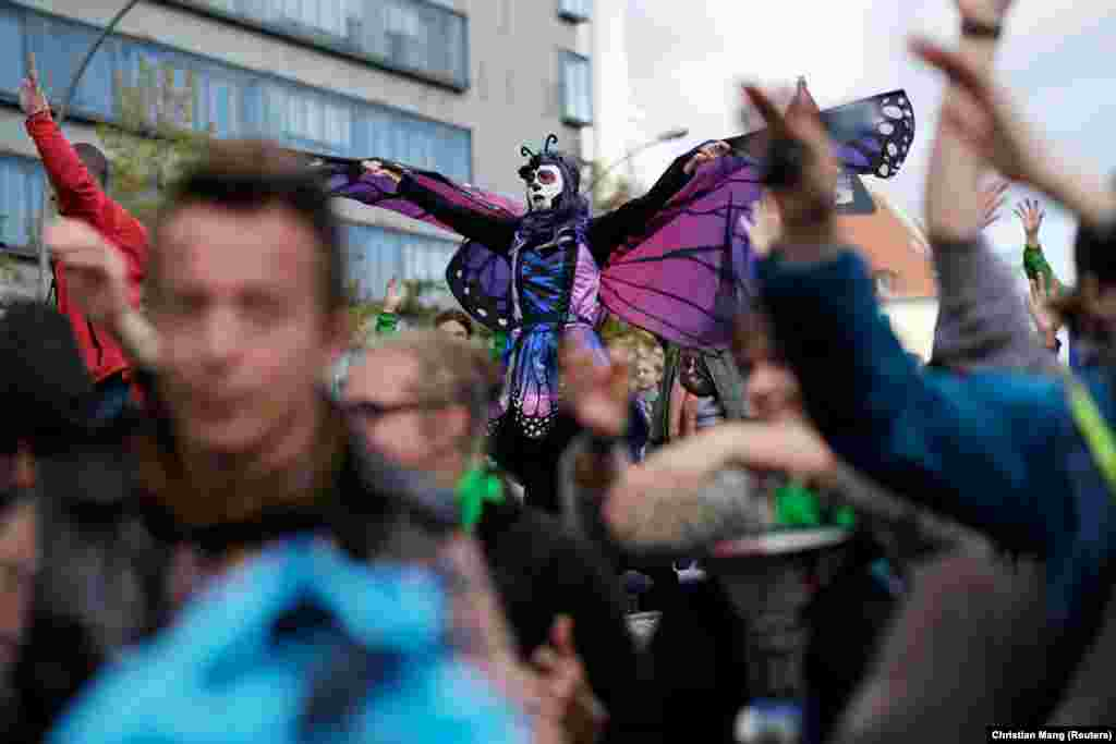 A protester wearing a costume takes part in the Extinction Rebellion's blockade of the Muhlendamm Bridge during the launch of a new wave of civil disobedience in Berlin on October 9. (Reuters/Christian Mang)