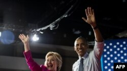 Барак Обама и Хиллари Клинтон во время минтинга в Шарлотте