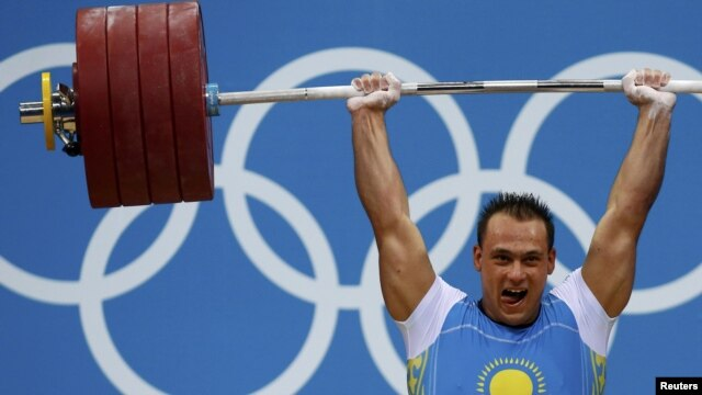 Kazakhstan's Ilya Ilyin set two new world records in weightlifting.