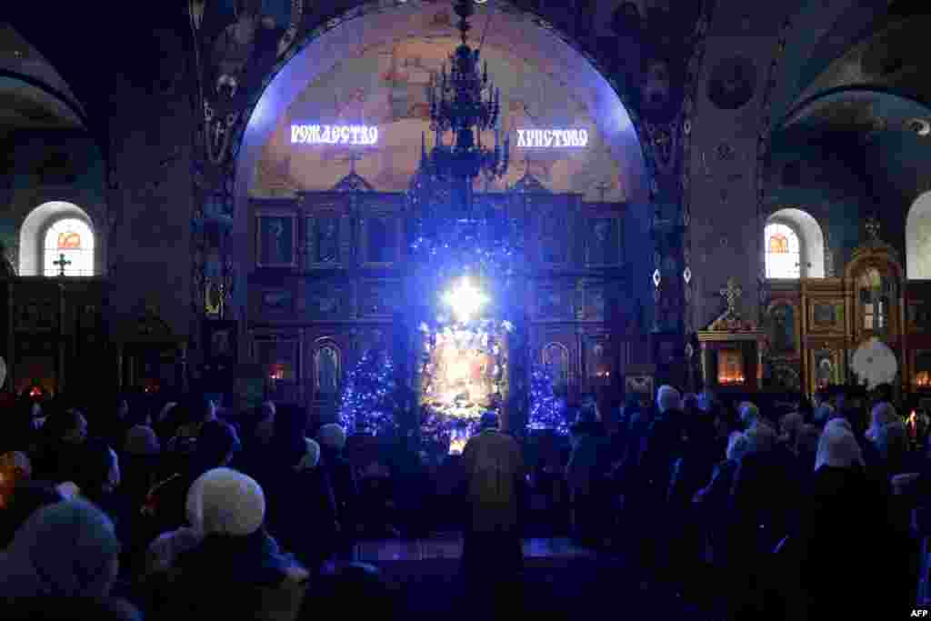 An Orthodox priest leads Christmas Eve Mass at the Aleksandr Nevsky Cathedral in the Crimean city of Simferopol.