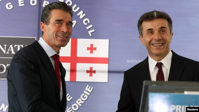 Georgian Prime Minister Bidzina Ivanishvili (right) meets with NATO Secretary-General Anders Fogh Rasmussen in Tbilisi on June 26.