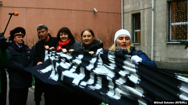 """Ukraine, We Are With You."" Boris Nemtsov and other activists outside the Ukrainian Embassy in Moscow on December 2."