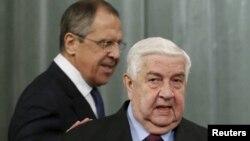 Rusiyanın xarici işlər naziri Sergei Lavrov (arxada) və onun suriyalı həmkarı Walid al-Moualem Moskvada görüşüblər