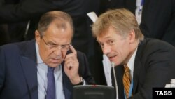 Russian Foreign Minister Sergei Lavrov (left) and Kremlin spokesman Dmitry Peskov (right) made their comments ahead of a scheduled meeting between Russian Deputy Foreign Minister Sergei Ryabkov and U.S. Undersecretary of State Thomas Shannon. (file photo)