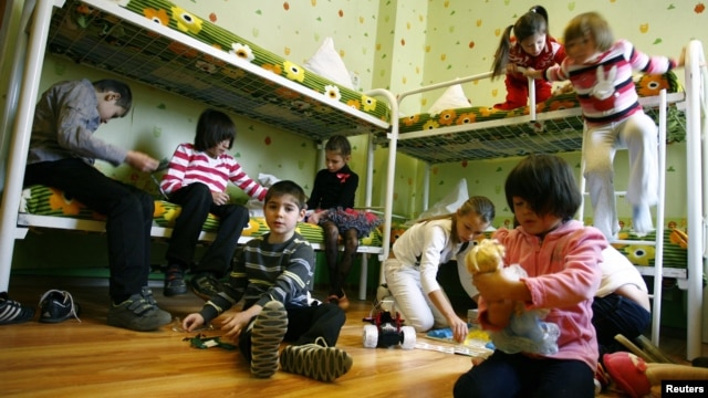 Children play in their bedroom at an orphanage in the southern Russian city of Rostov-na-Donu.
