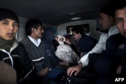 A group of Afghan and Palestine migrants is seen inside a police van in Nea Vissa, Greece. (file photo)