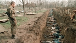 This photo -- showing a Russian soldiers inspecting bodies of civilians in a mass grave in Chechnya in 1995 -- was used by Russia's state-owned Channel One television to highlight recent Ukrainian suffering.
