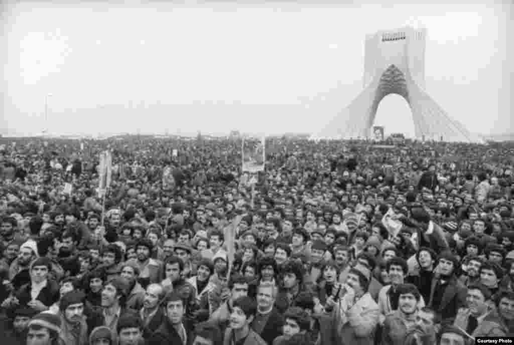 Some one million people gather in Freedom Square in Tehran as the Iranian Revolution begins in 1979.